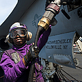 Airman Fuels An Fa-18c Hornet by Stocktrek Images