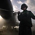 Airman Holds Up The Safety Shot Line by Stocktrek Images