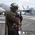 Airman Stands By With Tie-down Chains by Stocktrek Images