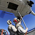 Airmen Attach Pallet Rigs To An Sa-330j by Stocktrek Images