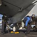 Airmen Chain Down An Fa-18e Super by Gert Kromhout