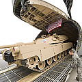 Airmen Load A Tank Into A C-5m Super by Stocktrek Images