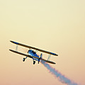 Airshow Smoke Trail At Sunset by Jim McKinley