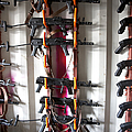Akm Assault Rifles Lined Up On The Wall by Terry Moore