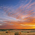 Amazing Sunset Over Pasture by Darwin Wiggett