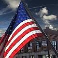 American Flag Flowing In Urban Landscape by Randall Nyhof