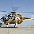 An Afghan Air Force Md-530f Helicopter by Giovanni Colla