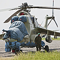 An Afghan Army Soldier Guards A Mi-35 by Terry Moore