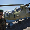 An Afghan Army Soldier Guards An Mi-35 by Terry Moore
