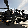 An Ah-64d Apache Helicopter Parked by Terry Moore