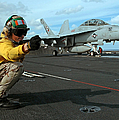 An Airman Gives The Signal To Launch An by Stocktrek Images