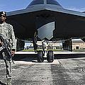 An Airman Guards A B-2 Spirit by Stocktrek Images