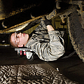 An Airman Inspects The Undercarriage by Stocktrek Images