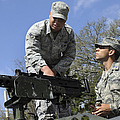 An Airman Instructs A Cadet On How by Stocktrek Images
