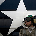 An Airman Stands In Front Of A C-2a by Stocktrek Images