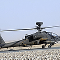 An Apache Helicopter Prepares by Andrew Chittock