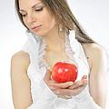 An Apple In Hands by Viktor Korostynski