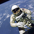An Astronaut Floats And Maneuvers by Stocktrek Images