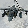 An Av-8b Harrier Receives Fuel by Stocktrek Images