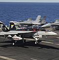 An Ea-18g Growler Lands Aboard Uss by Stocktrek Images
