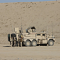 An Eod Cougar Mrap In A Wadi by Terry Moore