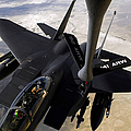 An F-15e Strike Eagle Aircraft Receives by Stocktrek Images