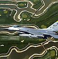 An F-16 Fighting Falcon Flies Near Base by Stocktrek Images
