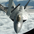 An F-22a Raptor Refuels With A Kc-135 by Stocktrek Images
