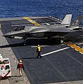 An F-35b Lightning II Makes A Vertical by Stocktrek Images