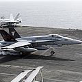 An Fa-18a+ Hornet Lands Aboard by Stocktrek Images