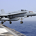 An Fa-18c Hornet Catapults by Stocktrek Images