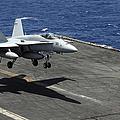 An Fa-18c Hornet Lands Aboard by Stocktrek Images