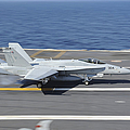 An Fa-18c Hornet Lands Aboard Uss by Stocktrek Images