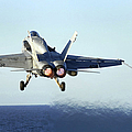 An Fa-18c Hornet Launches by Stocktrek Images