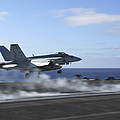 An Fa-18e Super Hornet Catapults by Stocktrek Images