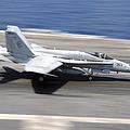 An Fa-18e Super Hornet Lands Aboard Uss by Stocktrek Images