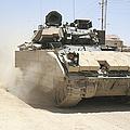 An M2 Bradley Fighting Vehicle Patrols by Stocktrek Images