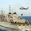 An Mh-60s Knighthawk Lifts Cargo by Stocktrek Images