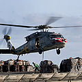 An Mh-60s Sea Hawk Lifts Cargo by Stocktrek Images
