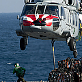 An Mh-60s Sea Hawk Picks Up Pallets by Stocktrek Images