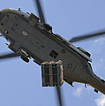 An Mh-60s Seahawk Helicopter Airlifts by Stocktrek Images