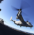 An Mv-22 Osprey Lands Aboard The Uss by Stocktrek Images