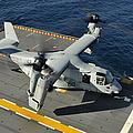 An Mv-22 Osprey Lands Aboard Uss by Stocktrek Images