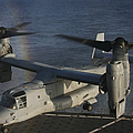 An Mv-22 Osprey Prepares To Land Aboard by Stocktrek Images
