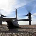 An Mv-22 Osprey Sits Outside A Forward by Stocktrek Images