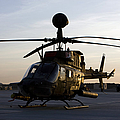 An Oh-58d Kiowa During Sunset by Terry Moore