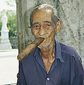 An Old Man Smokes An Over-sized Cigar by David Evans
