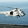 An Sh-3h Sea King Helicopter Prepares by Stocktrek Images