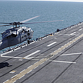 An Sh-60 Sea Hawk Helicopter Lands by Stocktrek Images