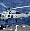 An Sh-60b Seahawk Helicopter Performs by Stocktrek Images